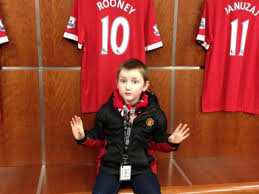 fan six year old john fitzgerald in the manchester united dressing room