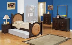 blue wall paint with dark brown wooden bed having sliding white ...