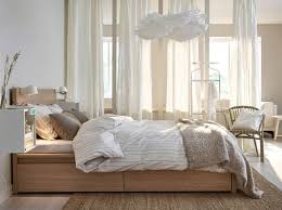Ikea MALM High bed frame in oak with bed textiles in white beige and light  brown