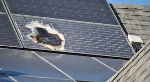 a solar panel damaged by fire roof l65