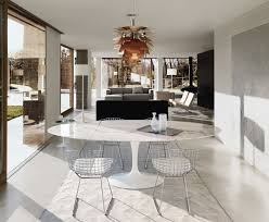 marble topped saarinen dining table in a residential dining room knoll inspiration