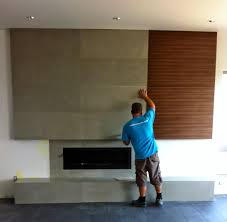 contemporary concrete fireplace with flush wood grain cabinetry concrete large format tiles created by mode concrete