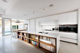 view in gallery kitchen island with bookshelves is an absolute showstopper in contemporary perth home design mata