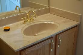 white marble Vanity Countertops with sink and gold faucet with double  handle for bathroom decor idea