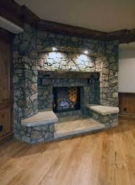 rustic stone corner fireplace design with hardwood flooring