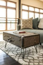 A custom coffee table made of a vintage suitcase is a great way to make a