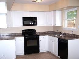 black appliances in kitchen off white cabinets with ideas78 kitchen