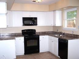 black appliances in kitchen off white cabinets with black appliances kitchen ideas kitchen black appliances with