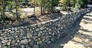 rock landscaping and construction is ready willing and able to meet your retaining wall needs check out this recent example of a lakefront project we