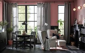 grey furniture living room. a living room with large windows is decorated in shades of black mauve and grey furniture n