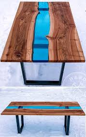 beautiful dining table made of wooden slabs elm with the live edges and of the glass