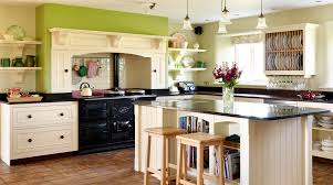 fascinating kitchens with white cabinets. Exciting White Cabinets Set With Hanging Kitchen Pendant Lamps Over Island Storage Added Two Backless Stool Also Wooden Floating Shelf In Traditional Fascinating Kitchens T