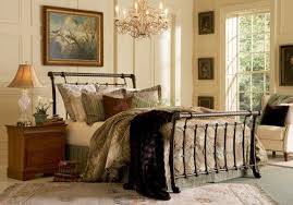 Chic Bedroom With A Chandelier Over Metal Sleigh Bed