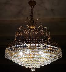 large crystal chandelier with gold leaf approx 1950 france