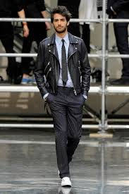 try pairing a black leather moto jacket with black striped dress pants for drinks after work