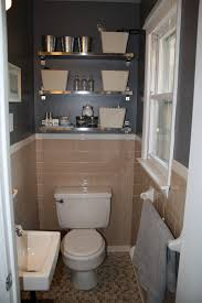 peach tile bathroom with grey walls plus fun shiny shelves in the bathroom ikea