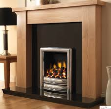 cleanly laminate floor combined with black table lamp also wooden fireplace surrounds design