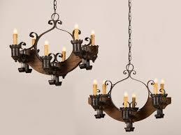 antique and vintage pair old wood chandeliers with black cast iron candle holder and hanging with chains ideas