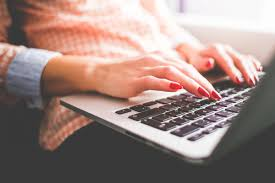 from editor to writer why i made a lateral career move earn writer types on her laptop