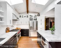 black and white two tone kitchen cabinets with marble countertop