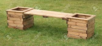 a wooden bench seat with two square garden planters stock photo planter boxes nz