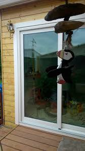 newly installed sliding glass doors that open onto a deck