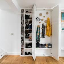 reach in closet design. Example Of A Trendy Gender-neutral Medium Tone Wood Floor Reach-in Closet Design Reach In