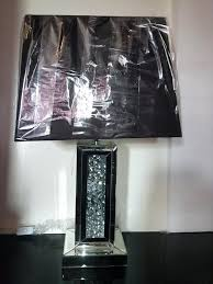 mirrored table lamp designed with a luxurious art style base complemented