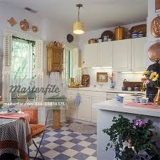 kitchen floor tiles with light cabinets. Contemporary Kitchen KITCHENS  White Cabinets And Counters Copper Collection Display  Bluewhite Tile Floor Potted Plants Lampshade As Hanging Light French Country  For Kitchen Floor Tiles With Light Cabinets H