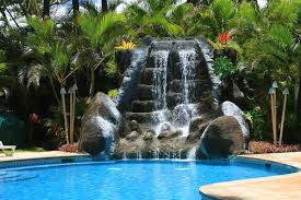in ground pools with waterfalls. Interesting Pools An Enormous Multitiered Artificial Waterfall Flowing Into The Far Edge Of  A Standard In Inside In Ground Pools With Waterfalls N