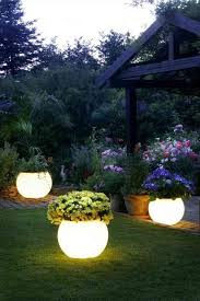 Garden Light: Illuminated Planters | 21 On A Budget DIY Landscaping Ideas  To Transform Your