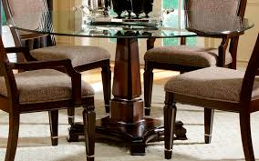 dining room modern decorative glass table top with round black mahogany varnished base single leg chairs white pattern fur rug oak laminate flooring set