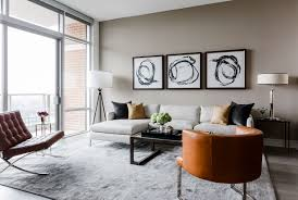 Plenty of seating in the main living and dining area was key, as Contreras'  client likes to entertain. A sectional and two leather chairs provide  places to ...