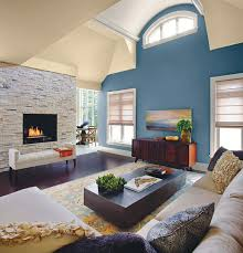 wonderful accent wall living room grey wall color tosca color fireplace wall white fireplace dark color sofa dark rounded table pictures
