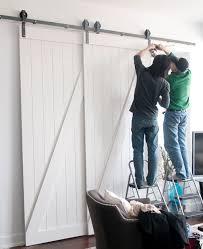 single store doors. single track bypass system - sliding barn door hardware kit for 2 doors on one store
