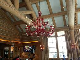 a beautiful red blown glass chandelier is the center piece of the cinnabar lounge
