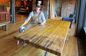 rustic furniture edmonton. Darren Cunningham Sits At A Table He Made From Boxcar Wood His Company Urban Rustic Furniture Edmonton