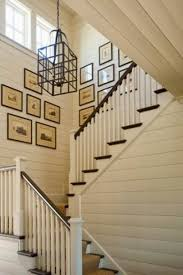 Architectural prints strategically placed around sconces make this stairwell  incredibly beautiful. We're drooling a little