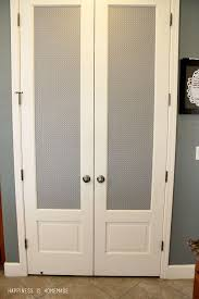 pantry door makeover with patterned shelf paper cover over those stained glass pantry doors