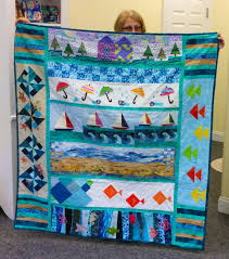 Row by Row — The Quilt Shop by Lois & Barbara Dorry from Sandy Hook, CT with her Row by Row H20 quilt. Adamdwight.com