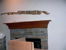 hanging a tv over gas fireplace above hiding wires