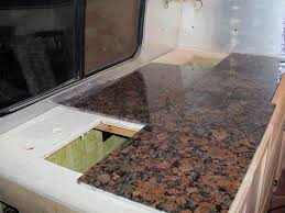 image of how to install granite tile countertops without grout lines
