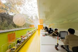 the tunnel shaped office with curved windows is a perfect example of uniting interior and exterior space the interior opens to the surrounding nature architectural office interiors