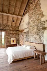 Modern Bedroom With Stone Walls And Wooden Ceiling