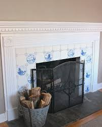 fireplace with faux blue and white delft tile