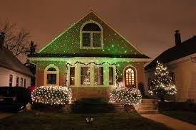 outdoor xmas lighting. Laser Christmas Lights Projected On House With A Simple Flood Light. BRILLIANT! Outdoor Xmas Lighting