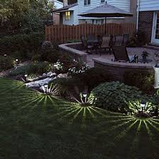 backyard solar lighting. i love the way these solar landscape lights create starlike patterns on lawn backyard lighting y