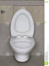 modern toilet bowl in a men bathroom stock photo  image