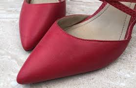 moldy red shoes before treatment