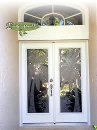 palm tree etched glass front doors